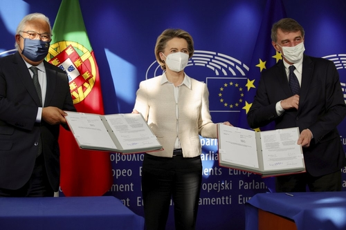 Portuguese Prime Minister and Council President António Costa, European Commission President Ursula von der Leyen, and European Parliament President David Sassoli after signing documents creating the EU's Recovery and Resilience Facility.