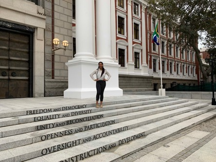 Danielle standing in front of Parliament before going to sit in on the Department of Home Affairs Portfolio Committee Elections and meeting.