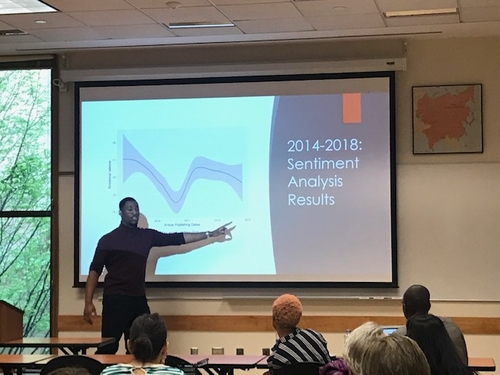 """Yale College Senior Ademide Ajayi discussing """"Natural Language Processing,"""" a subfield of computer science, as a way to understand public opinion about the Nigerian president."""