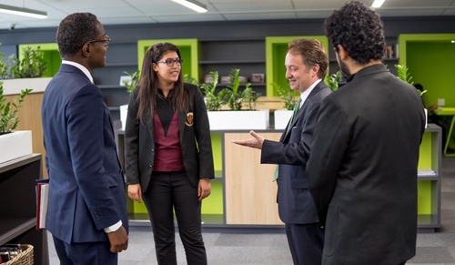 Pericles Lewis (second from right) visits with students and instructors at the African Leadership Academy in Johannesburg, South Africa.
