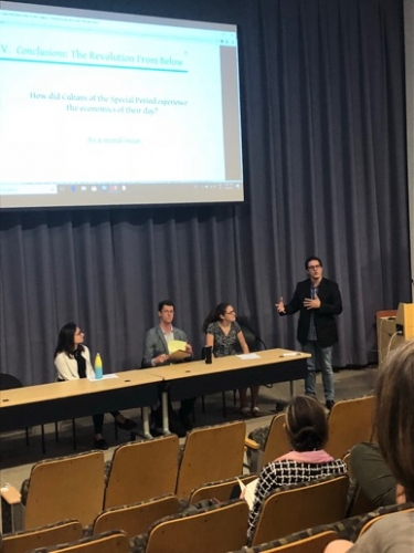 "Professor Funes moderating the first panel, ""Natural Resources in the Developmental Ages"" featuring Charlotte Dougall (Yale University), Eric Gettig (Georgetown University), and Caroline Kuritzkes (Yale University)."