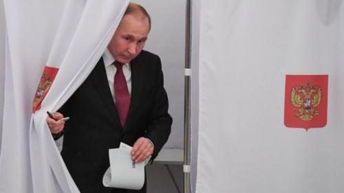 President Vladimir Putin voting in Sunday's presidential election.