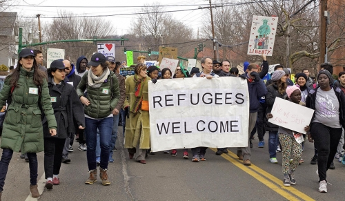 Marchers at the 2017 Refugee Run, organized by Integrated Refugee and Immigrant Services (IRIS), walking from East Rock to Downtown New Haven. The march concluded in speeches from city officials, refugees, and others to show support for the resettled members of the community.