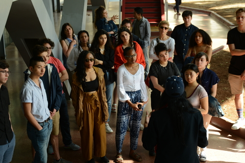 The group listens to tour guide Niurkis at the Museum of the Revolution. (Photo by Daniel Juarez)