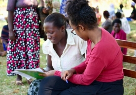 Nadira, one of our team members, conducts an English reading test with a CHP candidate in Buyengo. All CHPs must be able to read and interpret English, and finding out their reading ability is a key part of the interview day, which also includes an exam.