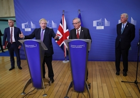British Prime Minister Boris Johnson and European Commission President Jean-Claude Juncker announcing agreement yesterday.