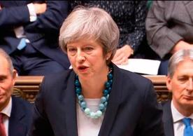 British Prime Minister Theresa May informing the House of Commons Monday that the vote on the EU-UK withdrawal agreement was being deferred.