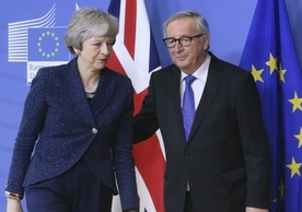 British Prime Minister Theresa May and European Commission President Jean-Claude Juncker in Brussels, Feb. 7, after agreeing to reopen talks on the political declaration on the future relationship.