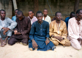 A group of men that Nigerian police identified as Boko Haram extremist fighters. A new study suggests messages from trusted religious leaders can persuade people to welcome former members of the terrorist group back into their communities. (Photo AP/Jossy Ola)