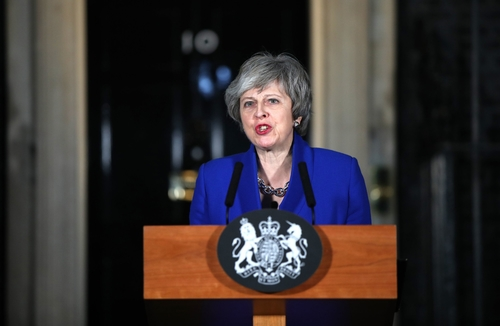 Prime Minister Theresa May speaking outside 10 Downing Street Wednesday evening after the vote of no confidence was rejected.